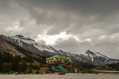 Parking for cars with two cars at the foot of the mountains and royalty free stock images