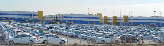 Parking crowded with new machines before the automobile plant Royalty Free Stock Images