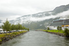 Parking cruise ship on sides of water channel. Stock Image