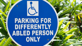 Parking for differently abled persons only. Sign using a politically correct and very complex way of saying handicapped parking. Parking for differently abled Royalty Free Stock Photo