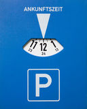 Parking Disc. German Parking Disc showing the time of arrival Royalty Free Stock Photography
