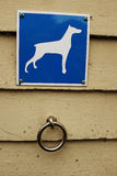 Parking for dogs, steel ring and a sign Stock Images
