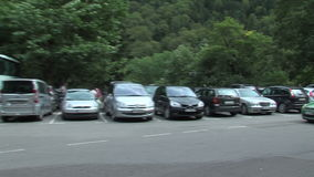 Parking at the entrance to the Rila Monastery in Bulgaria stock footage