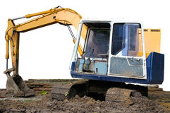Parking excavator. Yellow excavator parking on worksite Stock Images