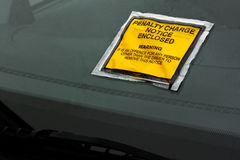 Parking fine. Parking ticket stuck on car windscreen a penalty or fine Stock Images
