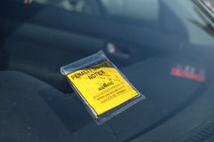 Parking fine penalty notice on windscreen Stock Photos