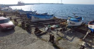 Parking of fishing boats in Pomorie from the height of the flight of seagulls, Bulgaria stock footage