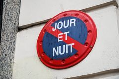 French no parking sign. Parking forbidden symbol day and night French: Jour et Nuit stock photos