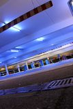 Parking garage. With bright neon lights at night Royalty Free Stock Photo