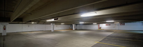 Parking garage. Empty parking lot underground garage panoramic scene royalty free stock image