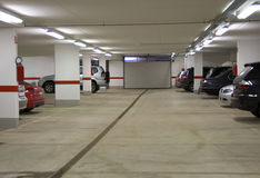 Parking garage. A parking garage underground with cars stock photography