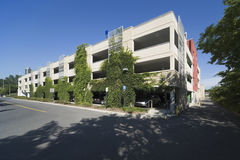 Parking garage. Modern parking garage with greenery growing up the front Stock Photography