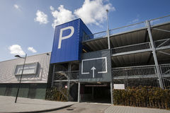 Parking garage with blank billboard. Blank billboard on a parking garage in Gouda. It's a public building with the entrance at the right side. A huge blue Royalty Free Stock Photos