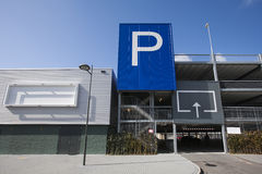 Parking garage with blank billboard. Blank billboard on a parking garage in Gouda. It's a public building with the entrance at the right side. A huge blue Royalty Free Stock Photo