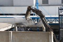 Parking Garage Demolition. Heavy equipment tearing down a parking garage Royalty Free Stock Photo