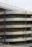 Parking garage driveway. A car drives up a spiral parking garage driveway Stock Photo