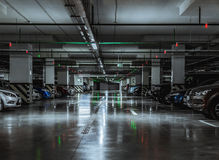 Parking garage with a few parked cars Royalty Free Stock Photo