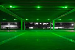 Parking garage with green light in free spots stock photos