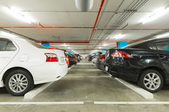 Parking garage interior with cars in industrial building, modern Royalty Free Stock Photo