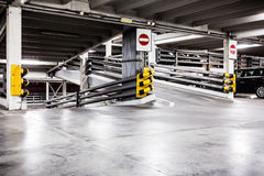 Parking garage interior and cars Royalty Free Stock Photo