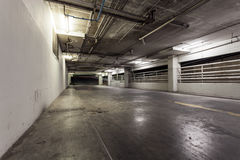 Parking garage interior, neon lights in industrial building. Stock Photos