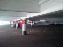 Parking garage. Lone, deserted concrete parking garage lot at daytime Stock Images