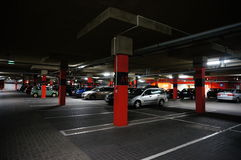 Parking garage. Many parked cars in the parking garage of the Factory Outlet shopping mall in Poznan, Poland stock photos