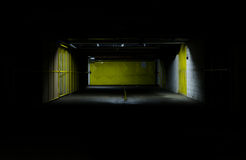 Parking garage at night Stock Images