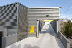 Parking garage ramp. A parking garage ramp to upper level with corrugated sheet metal exterior or siding stock images