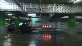 Parking garage, timelapse. Parking garage, underground interior with a few parked cars stock video footage