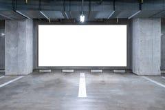 Parking garage underground with blank billboard Royalty Free Stock Image