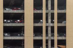 Parking garage, underground exterior with a few parked cars royalty free stock photos