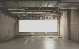 Parking garage underground interior with billboard Royalty Free Stock Photo