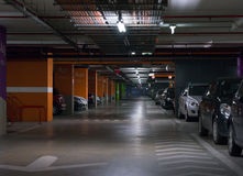 Parking garage. Underground interior with a few parked cars stock photo