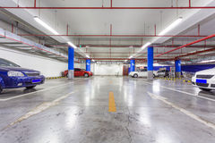 Parking garage, underground interior with a few parked cars Royalty Free Stock Photos