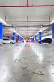 Parking garage, underground interior with a few parked cars Stock Image