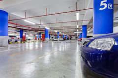 Parking garage, underground interior with a few parked cars Royalty Free Stock Photography