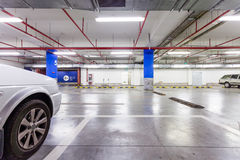 Parking garage, underground interior with a few parked cars Royalty Free Stock Image