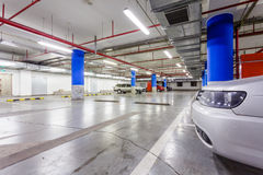Parking garage, underground interior with a few parked cars Stock Photos