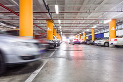 Parking garage, underground interior with a few parked cars Royalty Free Stock Photo