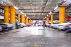 Parking garage, underground interior with a few parked cars Royalty Free Stock Images
