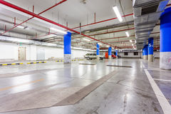 Parking garage, underground interior with a few parked cars Stock Photography