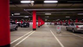 Parking garage, underground interior with a few. Parked cars. HD. 1920x1080 stock video