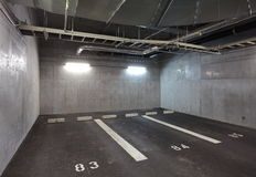 Parking garage. Underground interior, neon lights in dark royalty free stock photography