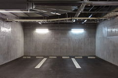 Parking garage. Underground interior, neon lights in dark stock photography