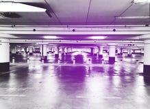 Parking garage underground interior, neon lights in dark industrial building, modern public construction. Royalty Free Stock Image