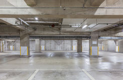 Parking garage underground interior with neon lights Royalty Free Stock Image