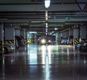 Parking garage, underground interior with a parked cars Stock Photos
