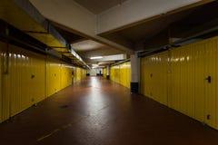 Parking garage underground interior. View of an underground garage with yellow doors royalty free stock photos