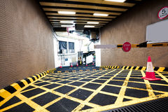 Parking garage underground interior of yellow zebra crossing Stock Image